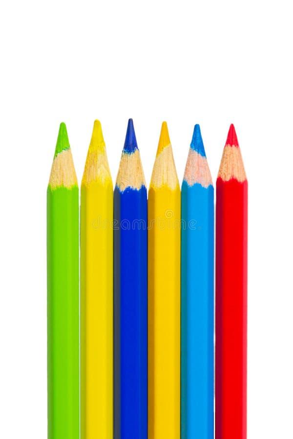 F?rgrika blyertspennor som isoleras p? vit bakgrund fotografering för bildbyråer