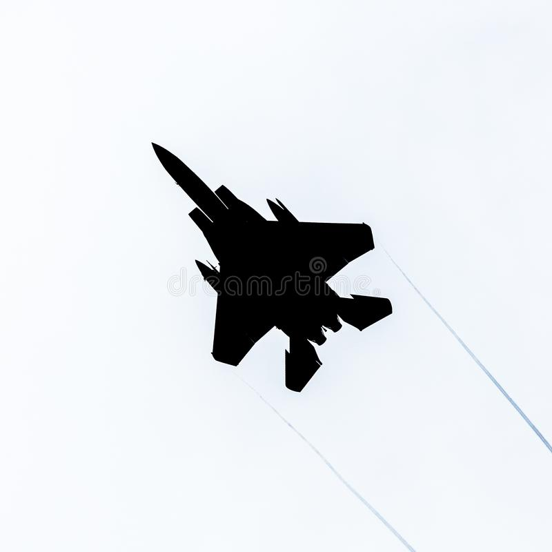 F15 Strike Eagle fighter jet silhouette. United States Air Force USAF F15 Strike Eagle military fighter jet silhouette, isolated royalty free stock photography