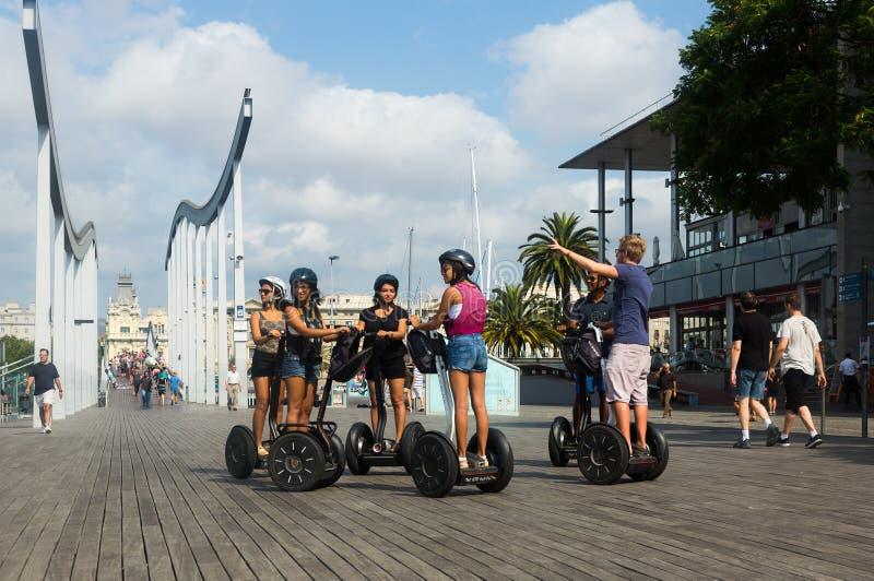 F tourist on Segway Tour at Port Vell. Barcelona. BARCELONA, SPAIN - JULY 6, 2014: Group of tourist on Segway Tour at Port Vell. Barcelona, Spain stock image