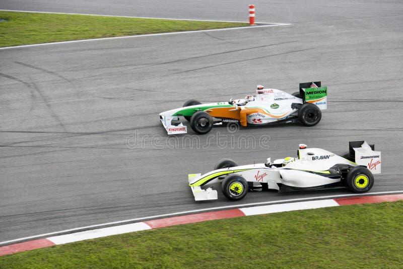 F1 che corre 2009 - sorpassare azione immagini stock