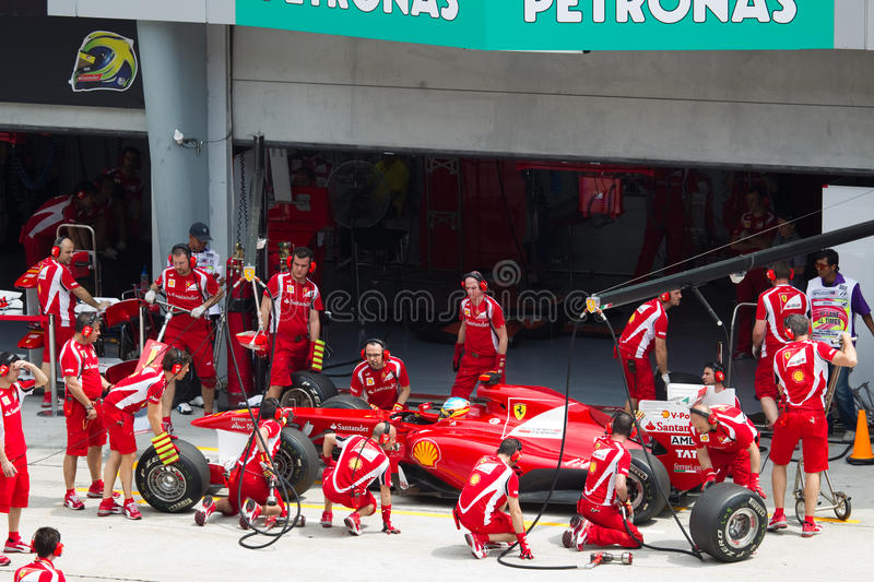 F1 driver Fernando Alonso does a trial pit stock images