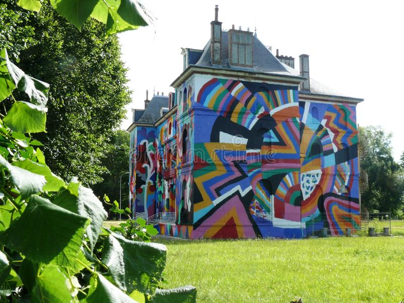 Façade of Château LaBel Valette decorated in street art. In Pressigny les Pins in Loiret in France stock photos