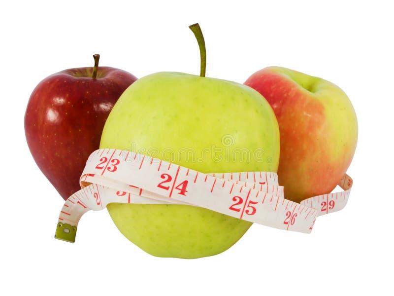 Faça dieta o conceito com uma maçã verde e uma fita da medida imagens de stock royalty free