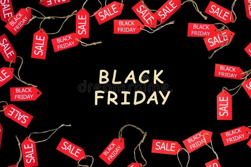 Façonnez les vacances noires de vendredi Labels de achat rouges de remise de vente images stock
