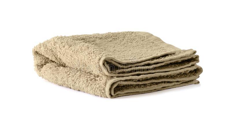 Fałdowy brown ręcznik odizolowywający na bielu fotografia stock
