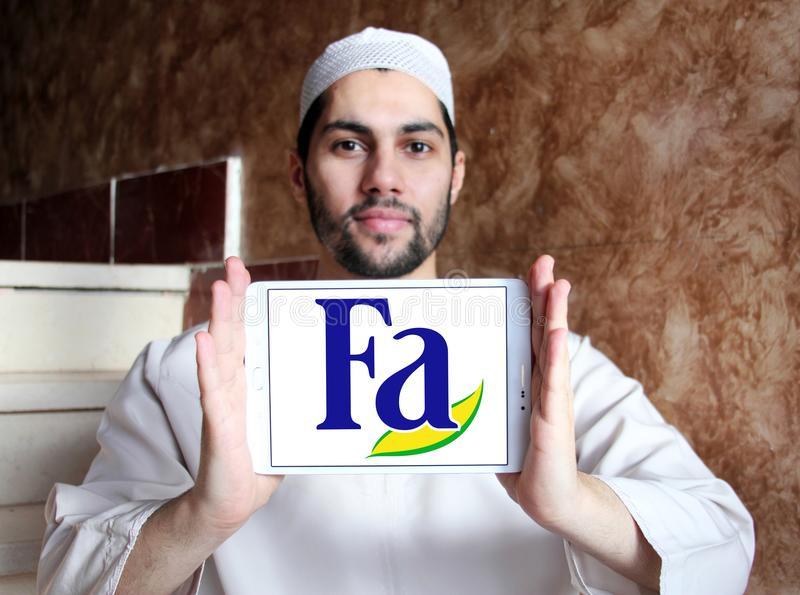 Fa brand logo. Logo of Fa brand on samsung tablet holded by arab muslim man. Fa is an international brand for personal care products. It is a subsidiary of stock photo