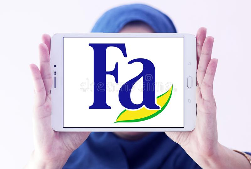 Fa brand logo. Logo of Fa brand on samsung tablet holded by arab muslim woman. Fa is an international brand for personal care products. It is a subsidiary of stock images
