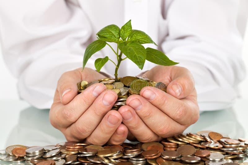 Fabbricazione soldi e del concetto di buoni investimenti fotografia stock