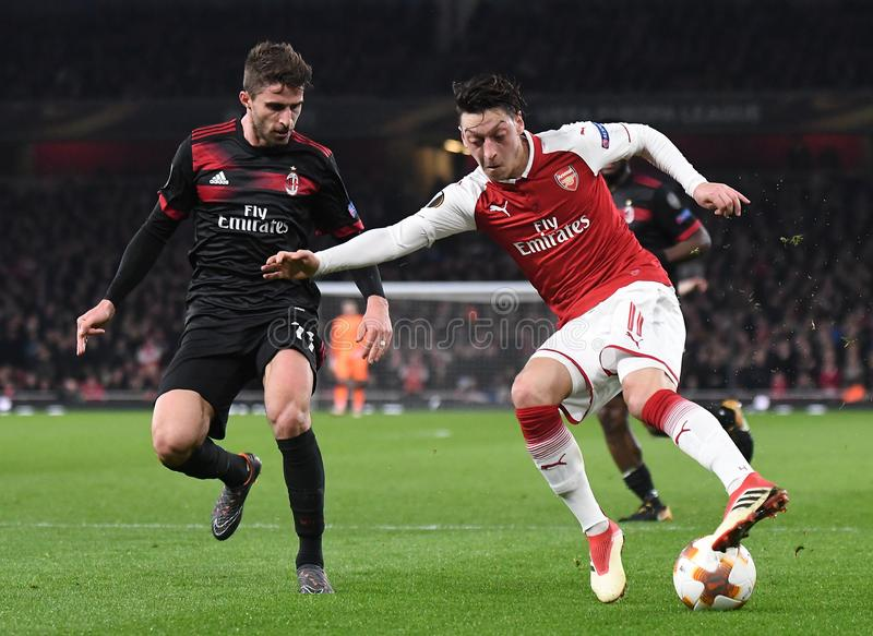Fabio Borini and Mesut Ozil. Players pictured during the UEFA Europa League Round of 16 game between Arsenal FC and AC Milan held on March 15, 2018 at Emirates royalty free stock images
