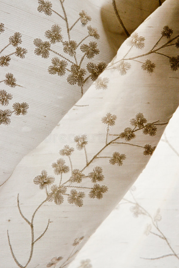 Fabric. Close-up of white fabric with flowers stock image
