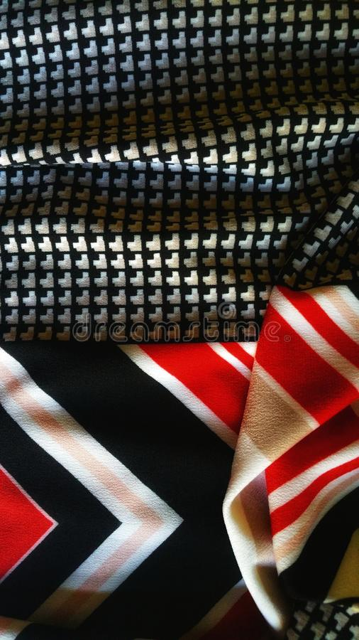 Fabric abstract. Red, black, gold and white. Mixed patterns. royalty free stock photo