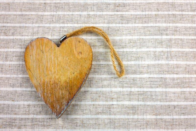 Decorative hearts on wood . Fabric background. royalty free stock image