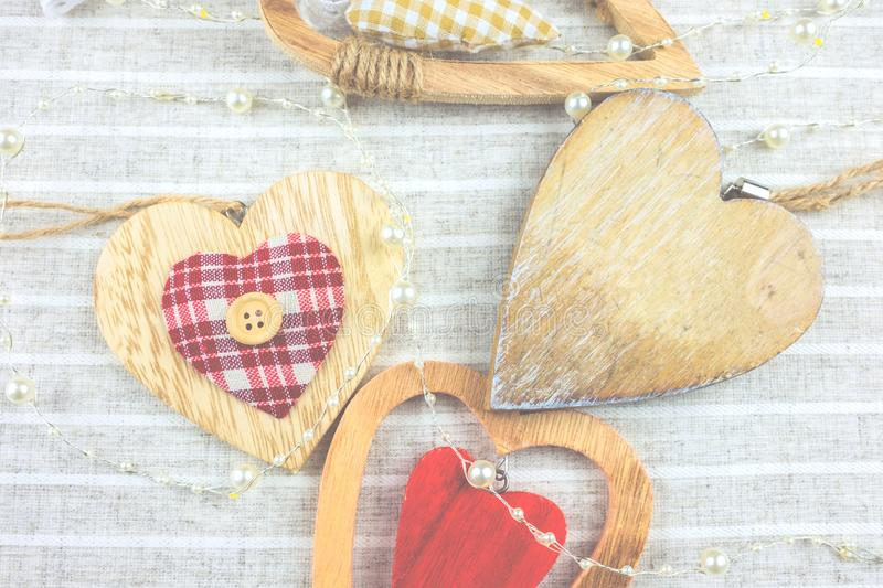 Many different decorative hearts on wood . royalty free stock image
