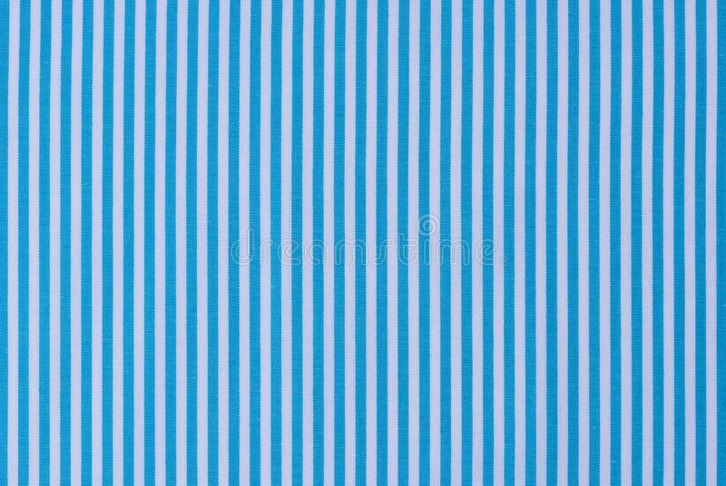 Fabric background texture of light blue and white vertical striped pattern stock image