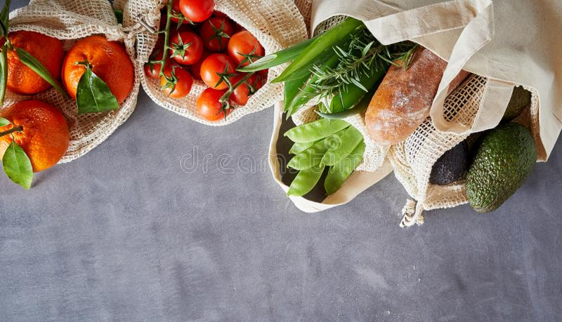 Fabric bags with fresh organic groceries royalty free stock photo