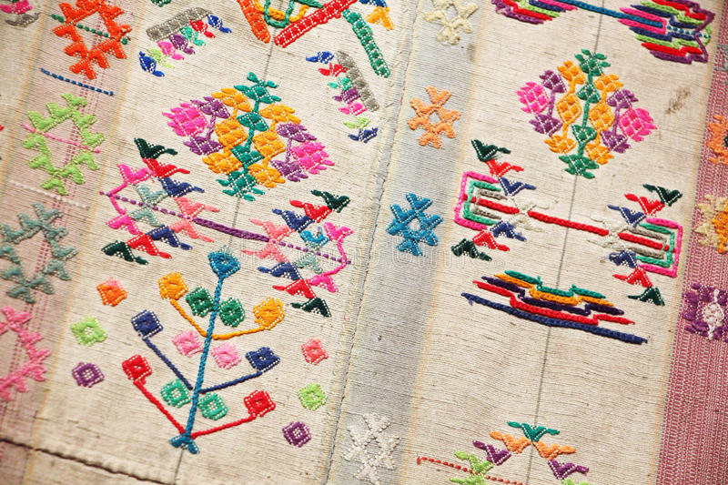 Fabric from bhutan. A detailed view of the texture and the colours of a dress for women from bhutan, landscape cut stock images