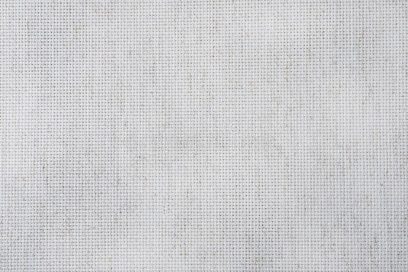 Fabric canvas for cross stitch crafts. Texture of cotton fabric stock photo