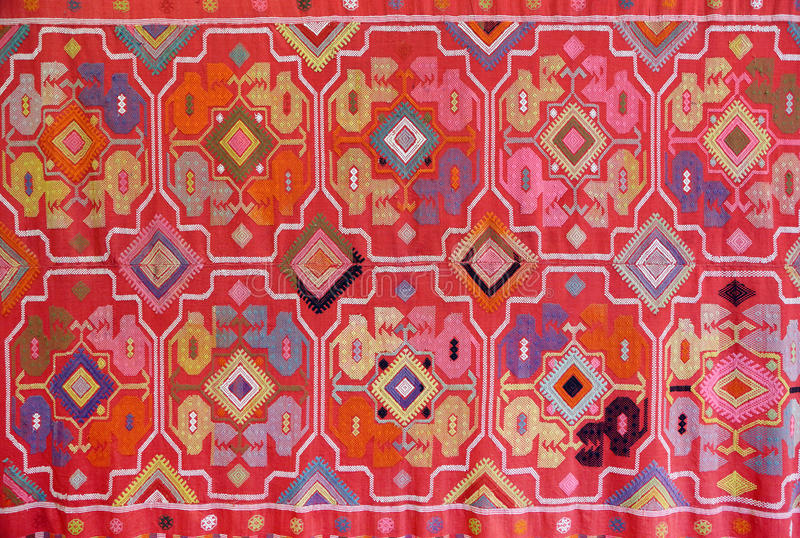 The fabric embroidered with oriental ornaments. Background stock images