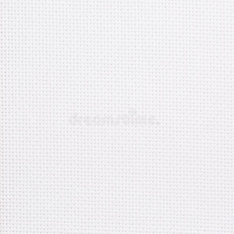 Fabric for embroidery with a cross. Cotton fabric for embroidery paintings. royalty free stock photos