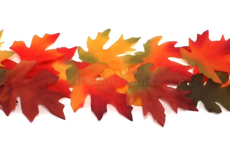 Fabric fall colored maple and oak leafs royalty free stock images