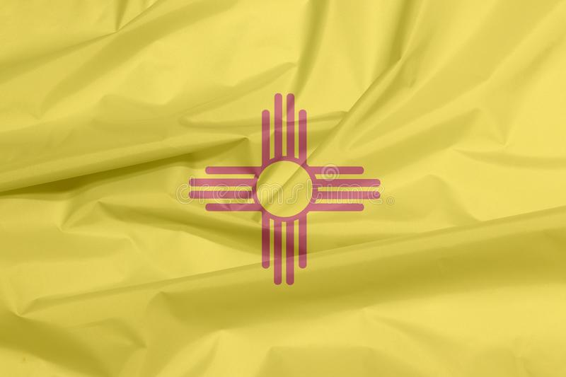 Fabric flag of New Mexico. Crease of New Mexico flag background, The states of America. stock photos