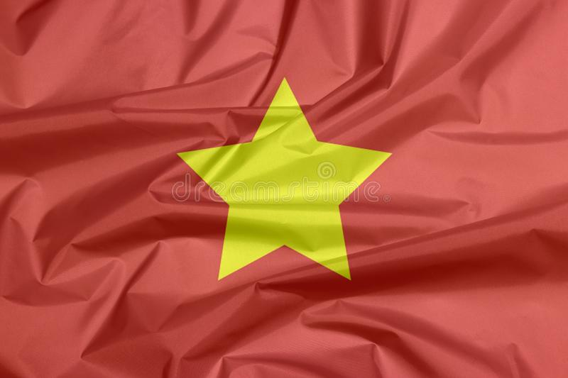 Fabric flag of North Vietnam 1945 to1955. Flag of Democratic Republic of Vietnam yellow star on red royalty free stock photos