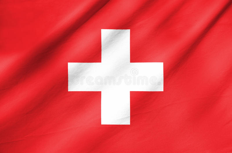 Fabric Flag of Switzerland. Waving in the wind Fabric Flag of Switzerland stock images