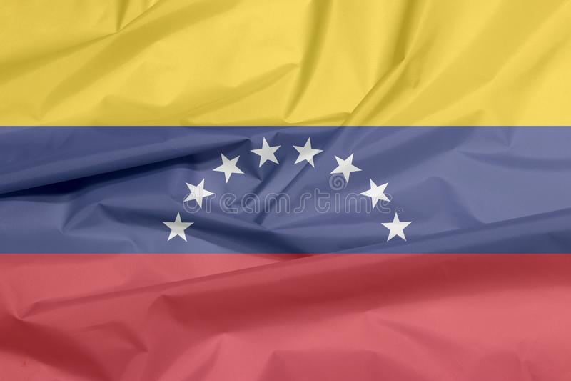 Fabric flag of Venezuela. Crease of Venezuelan flag background. vector illustration