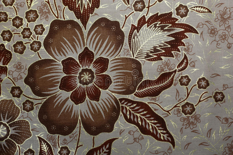 Fabric with floral batik pattern stock images