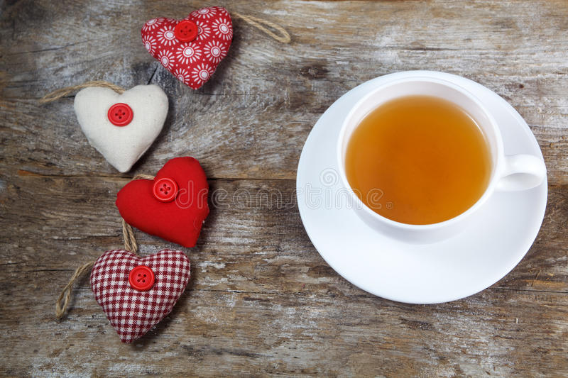 Fabric hearts and cup of tea stock photo