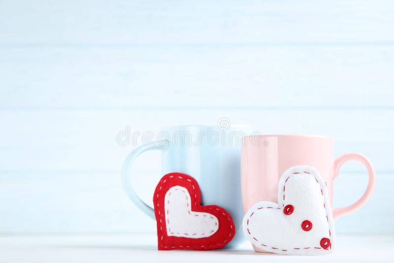 Hearts with cups stock image