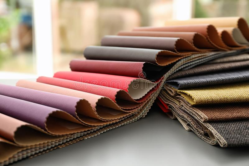 Fabric and leather samples of different colors royalty free stock photo