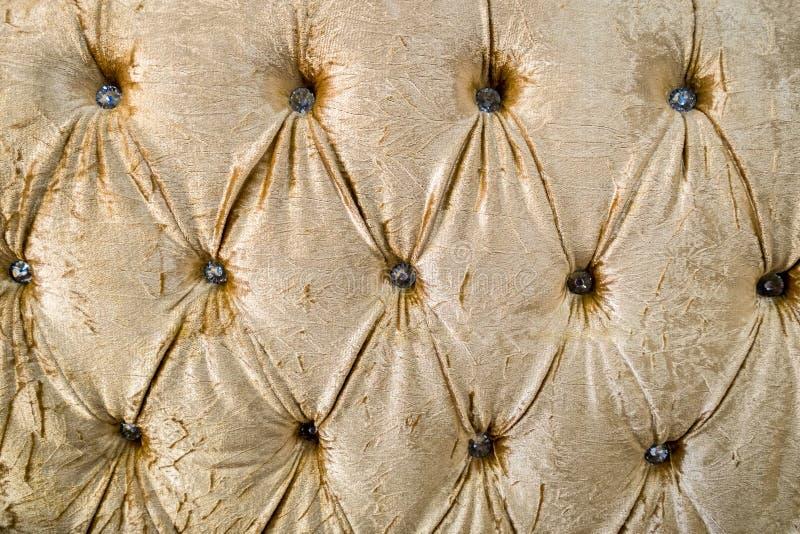 Fabric leather yellow gold elegant sofa cushion texture royalty free stock image