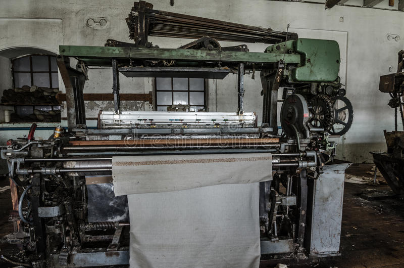 Fabric on machine in spinning. Clamped fabric on machine in spinning factory royalty free stock images
