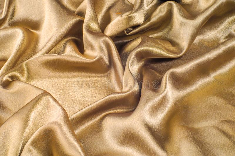 Fabric made of silk fabric metal thread metallic sheen gold. Just like looking at a stunning waterfall, this golden yellow Silk C. Harmeuse stands alone stock photography