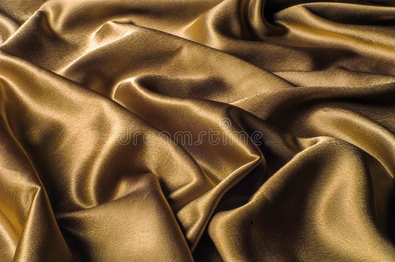 Fabric made of silk fabric metal thread metallic sheen gold. Just like looking at a stunning waterfall, this golden yellow Silk C stock images