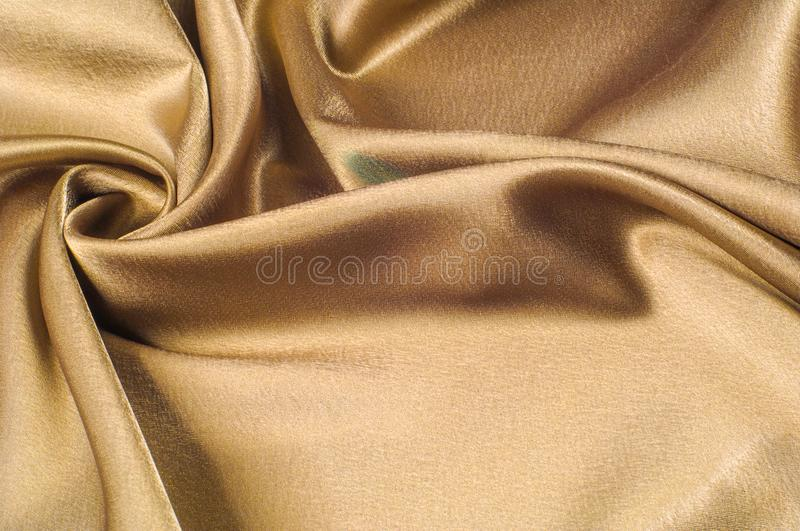 Fabric made of silk fabric metal thread metallic sheen gold. Just like looking at a stunning waterfall, this golden yellow Silk C. Harmeuse stands alone royalty free stock photography