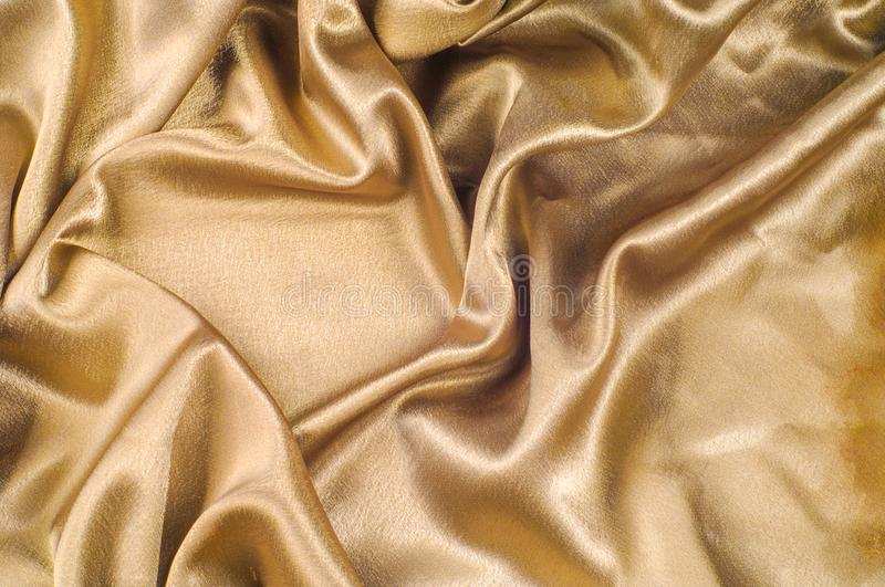 Fabric made of silk fabric metal thread metallic sheen gold. Just like looking at a stunning waterfall, this golden yellow Silk C. Harmeuse stands alone royalty free stock images