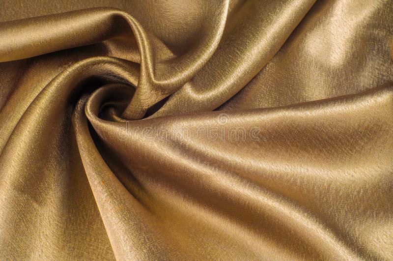 Fabric made of silk fabric metal thread metallic sheen gold. Just like looking at a stunning waterfall, this golden yellow Silk C. Harmeuse stands alone stock images
