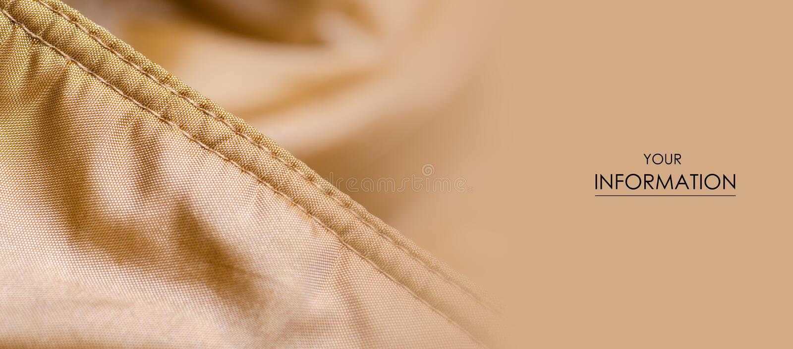 Fabric material textile texture golden seam  blur background. Fabric material textile texture golden seam jacket lining macro pattern blur background stock photos