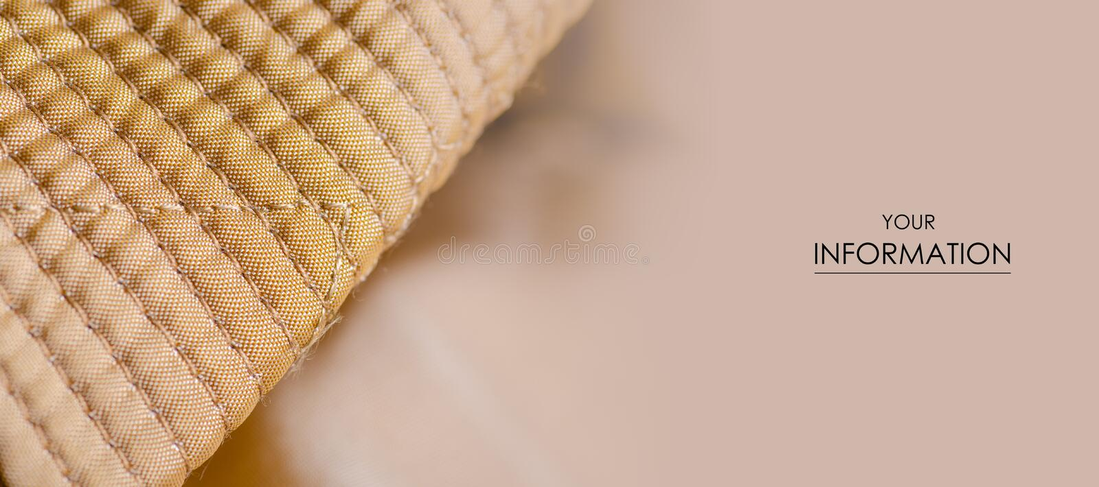 Fabric material textile texture golden seam  blur background. Fabric material textile texture golden seam jacket lining macro pattern blur background stock images