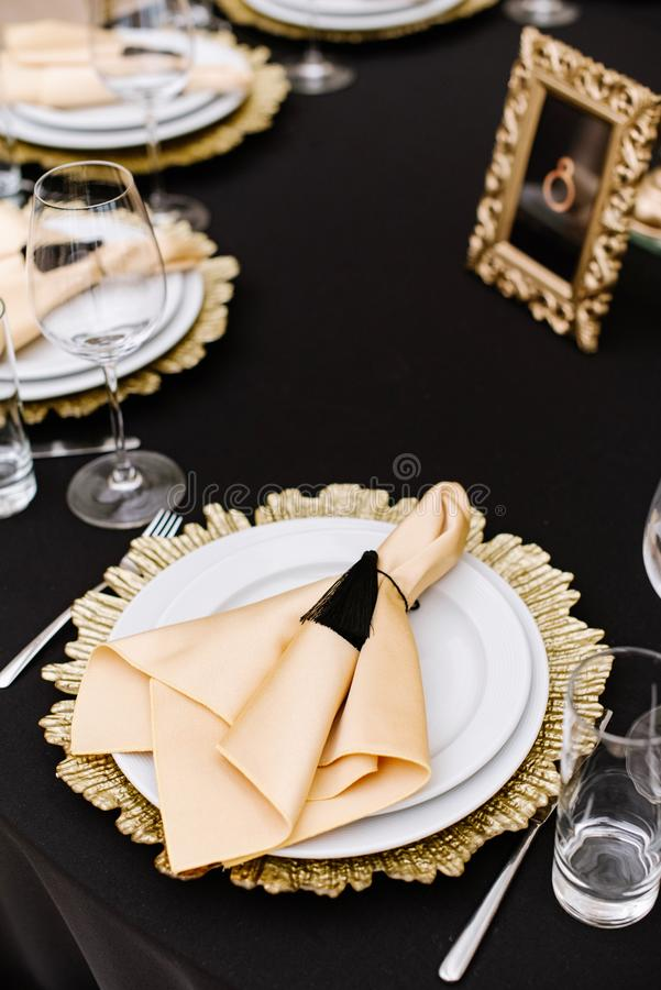Fabric napkin for the guest at the holiday dinner. Beautiful service of wedding tables. royalty free stock photos
