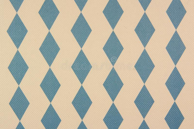 Fabric with a pattern of light blue rhombs on the white background stock photography