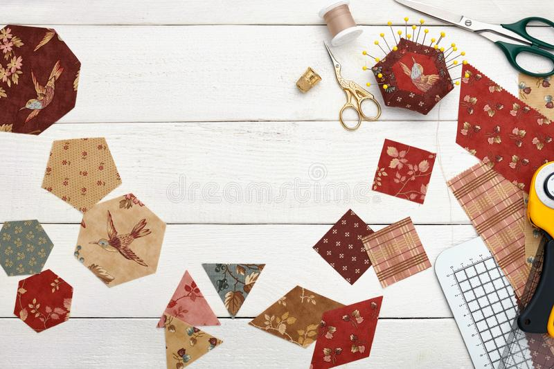 Fabric pieces of different geometric shapes for sewing quilt, traditional patchwork, sewing and quilting accessories stock photography