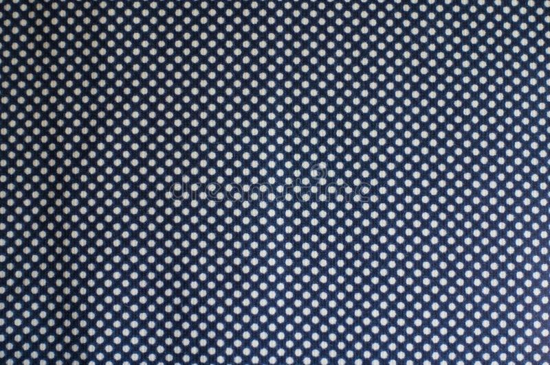 Fabric with polka dot pattern from above royalty free stock image