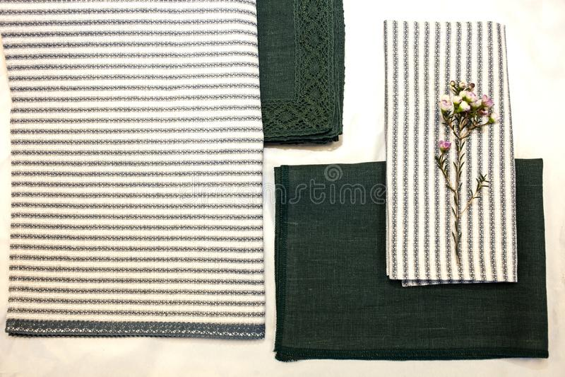 Fabric sample green and white blue linen. Textile manufacture. A sample of natural green linen fabric folds. Textile manufacture. texture of high quality fabric stock image