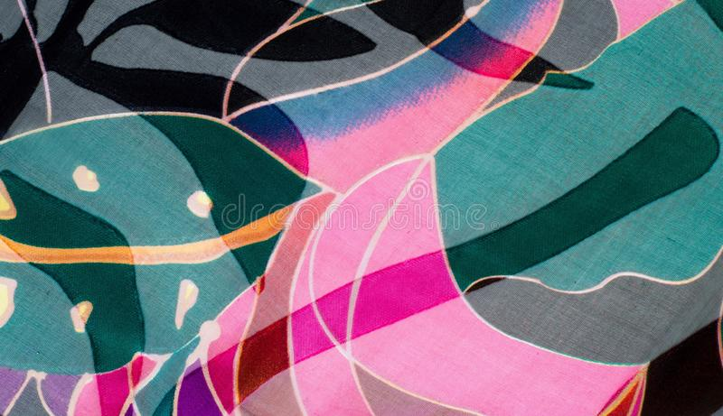 Fabric silk texture. abstract painting. Bstract wave pattern on silk batik. a fine, strong, soft, lustrous fiber produced by silkworms in making cocoons and stock image