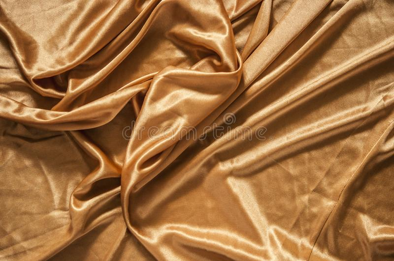 Fabric silk texture for background. Gold silk texture of satin abstract background royalty free stock images