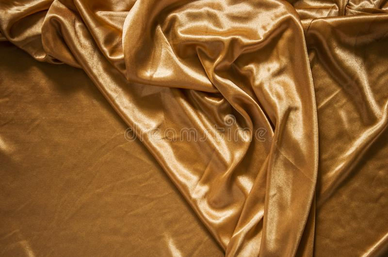 Fabric silk texture for background. Gold silk texture of satin abstract background stock images