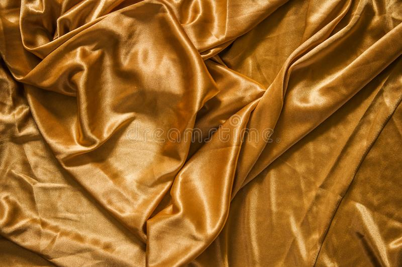 Fabric silk texture for background. Gold silk texture of satin abstract background stock photos